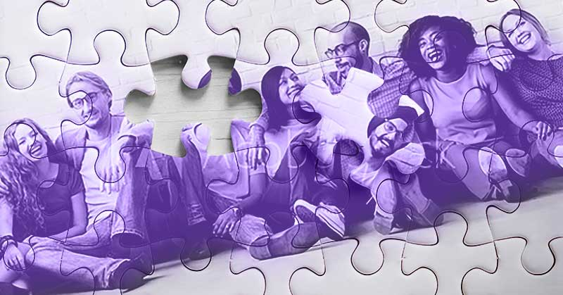 Illustration. A group of young people sit together in a very friendly pose. Some have arms around each other. They look ... they project camaraderie. The photo is also superimposed as a puzzle and one piece of that puzzle is missing.