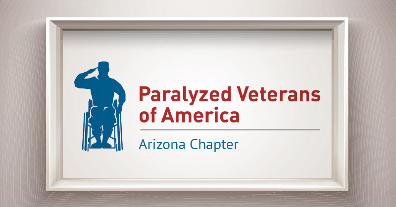The logo for the Paralyzed Veterans of America framed and hung on a wall. The logo has a blue silhouette of a veteran in uniform who is in saluting stance and is using a wheelchair.