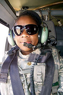 Toni Grimes wearing military gear.
