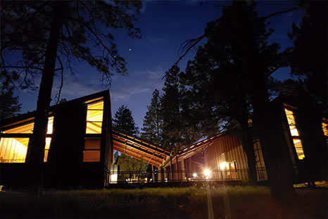 A photo of cabins at night.