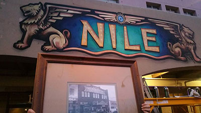 The building logo in front of the Nile Theater.