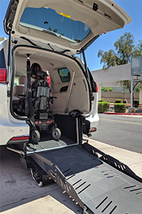 Image shows the back of a van with a ramp providing access to wheelchair-users.