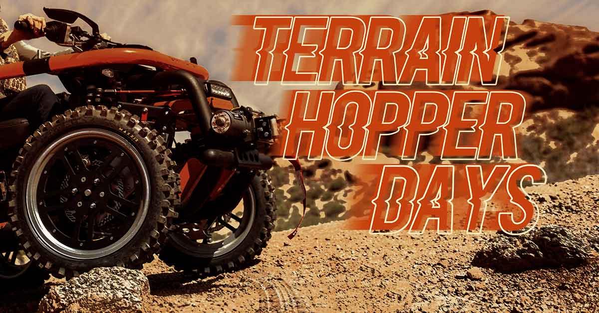 Terrain Hopper Days, A large 4 wheel vehicle is climbing over rocks.