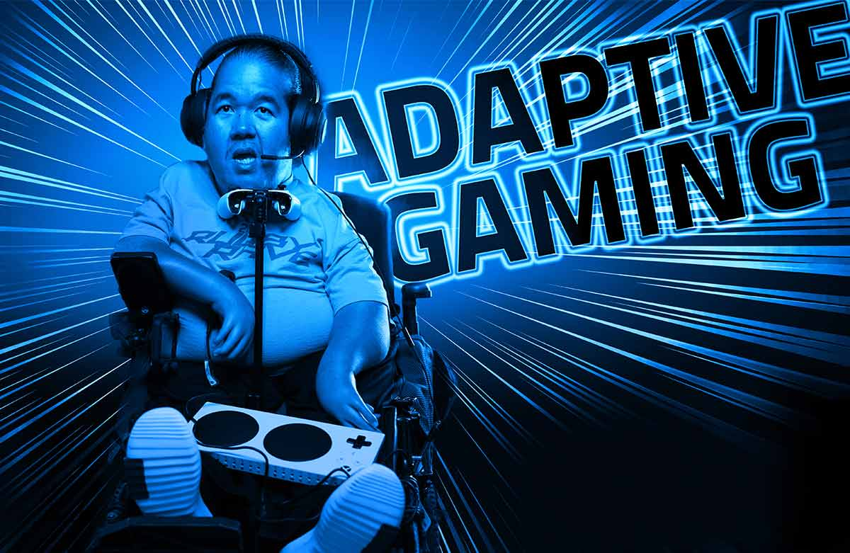 PHOTO: A blue-tinted photo shows a middle-aged man looks straight at the camera with his mouth open in shock. He wears over-the-ear headphones that has a microphone pointed toward his mouth. A white Xbox controller is held up by a stand and sits beneath his chin so he can move the joystick with his chin. His legs stick out at the camera and resting on his legs is an adaptive Xbox controller that serves as a hub for all other adaptive controls for video games.