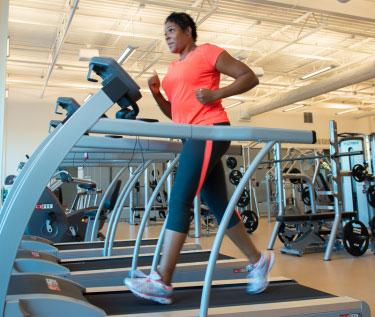 A woman using a treadmill