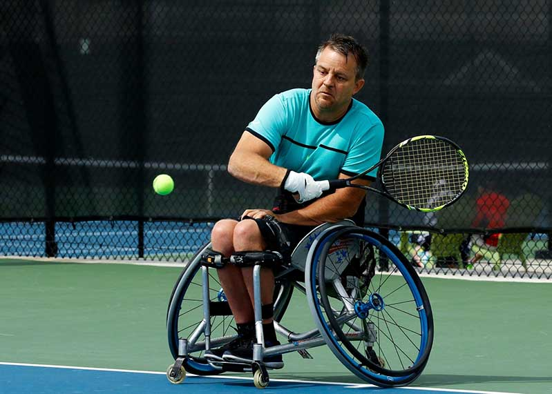 Bryan Barten, head coach of wheelchair tennis at U of A, plays wheelchair tennis.