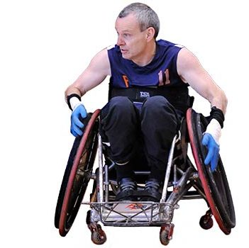Phil Pangrazio sits in a rugby wheelchair with his hands on the sidebars propelling him forward. He wears a blue rugby jersey with an orange number 11 on it.