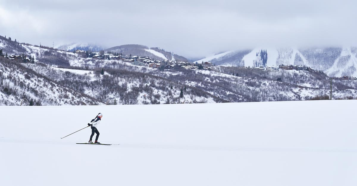 A photo of an adaptive skier in the background.