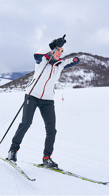 A photo of a double arm amputee skiing.